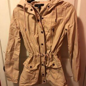 Light pink fall jacket with drawstring waist.